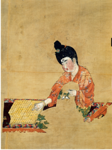 (Left: mural of Woman Playing Go (Tang Dynasty c. 744), discovered at the Astana Graves.
